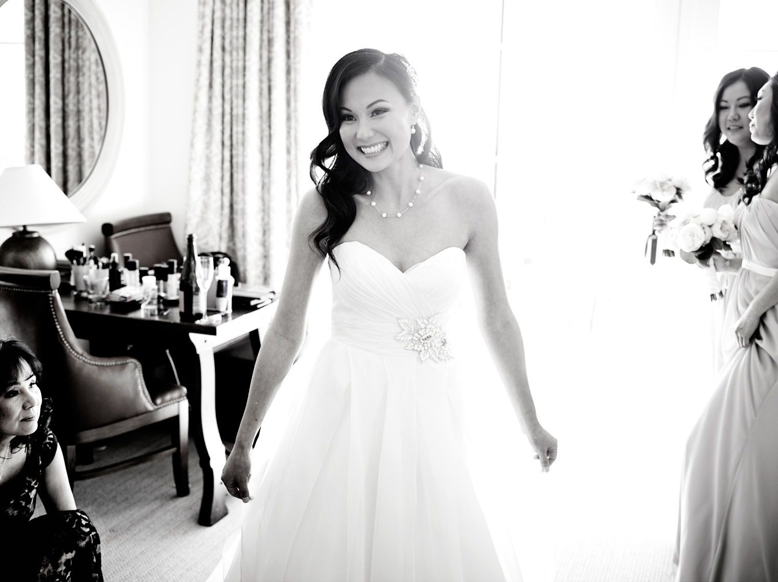 Bride puts on wedding dress at Terranea Resort in Rancho Palos Verdes, CA