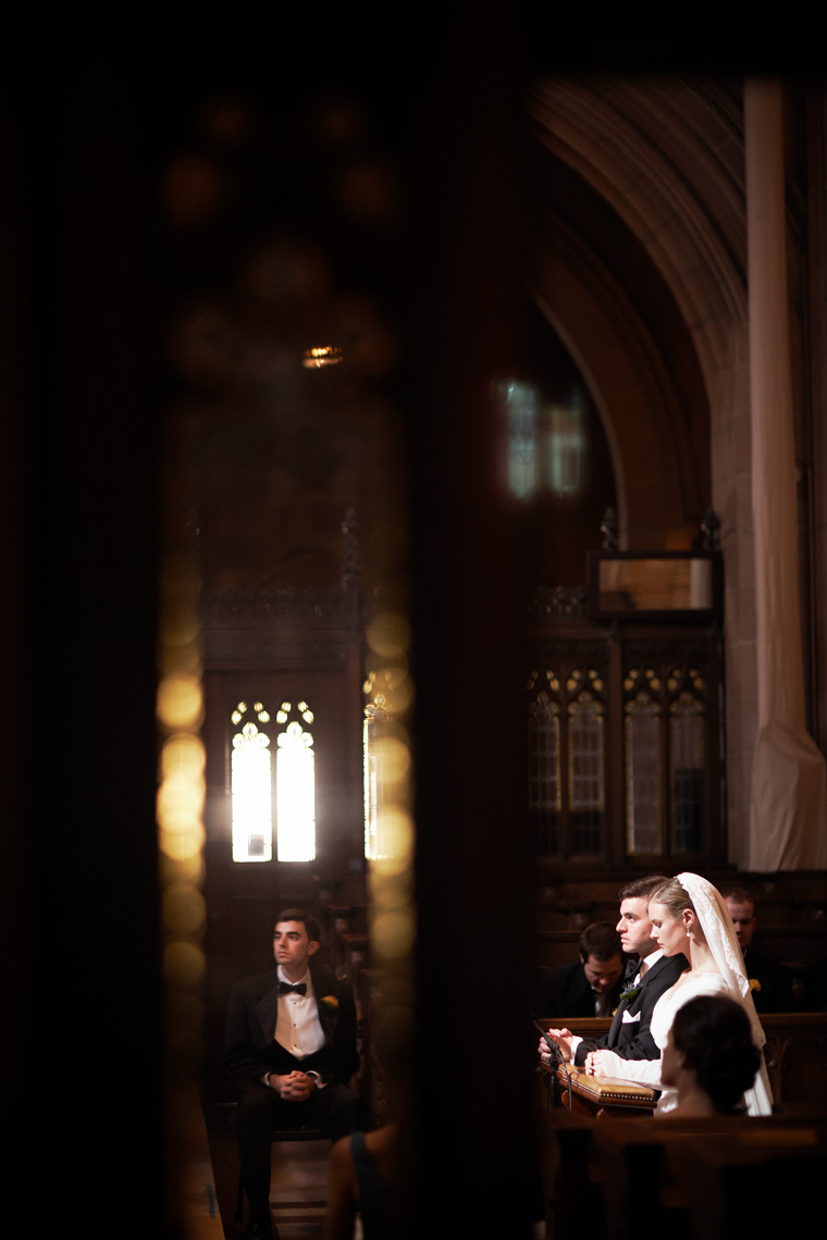 Bride and Groom kneel during wedding ceremony at Saint Dominic