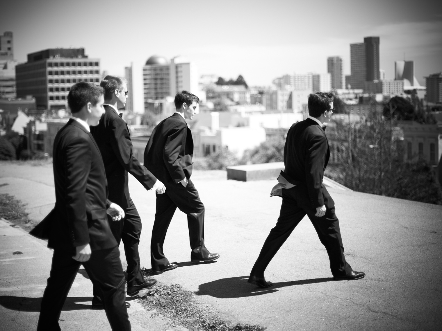 Groomsmen walk through Downtown San Francisco prior to wedding ceremony