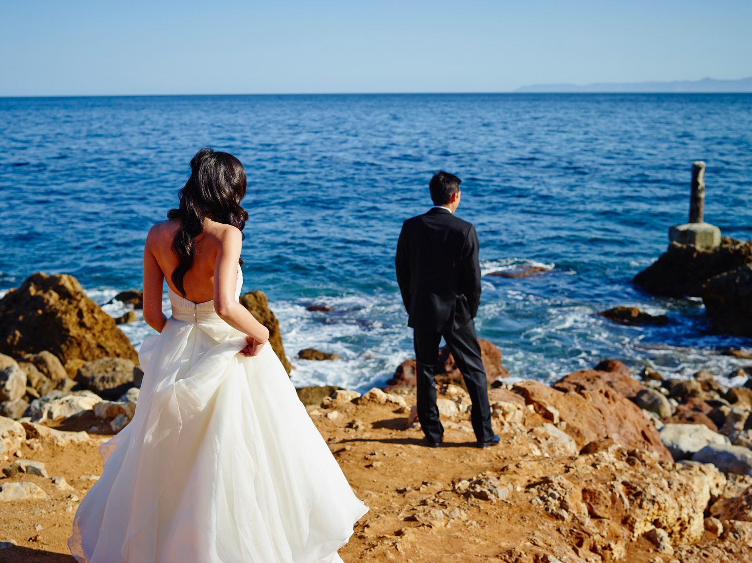 Bride walks toward Groom for first look at Terranea Resort in Rancho Palos Verdes