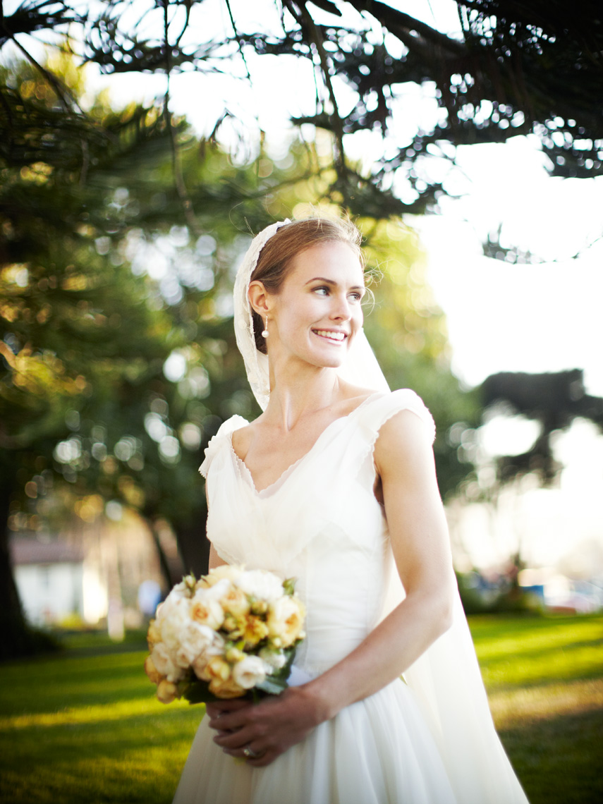 Bride poses with bridal bouquet at Fort Mason San Francisco, California