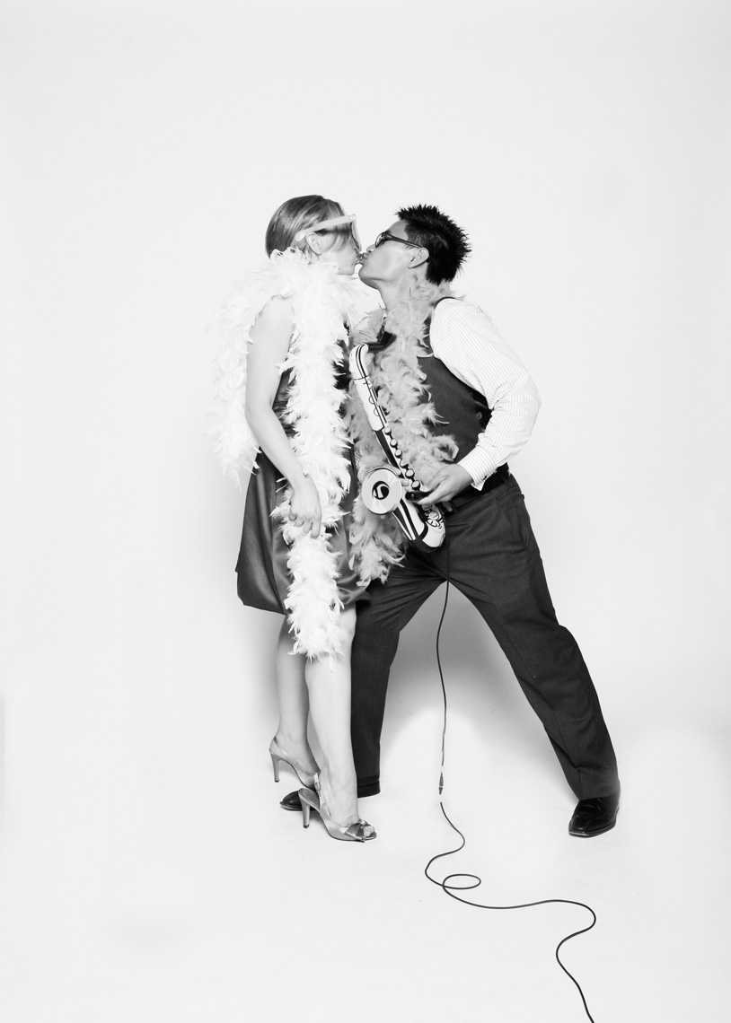Couple kisses in photo booth at wedding in San Francisco California