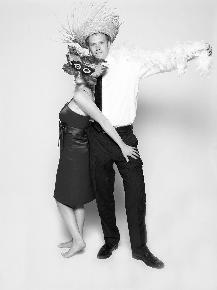 Couple poses in photo booth at wedding in San Francisco California
