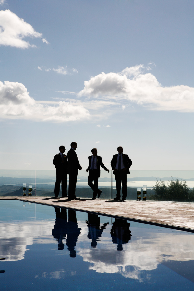 Groomsmen prepare for wedding at private estate in Napa Valley, California