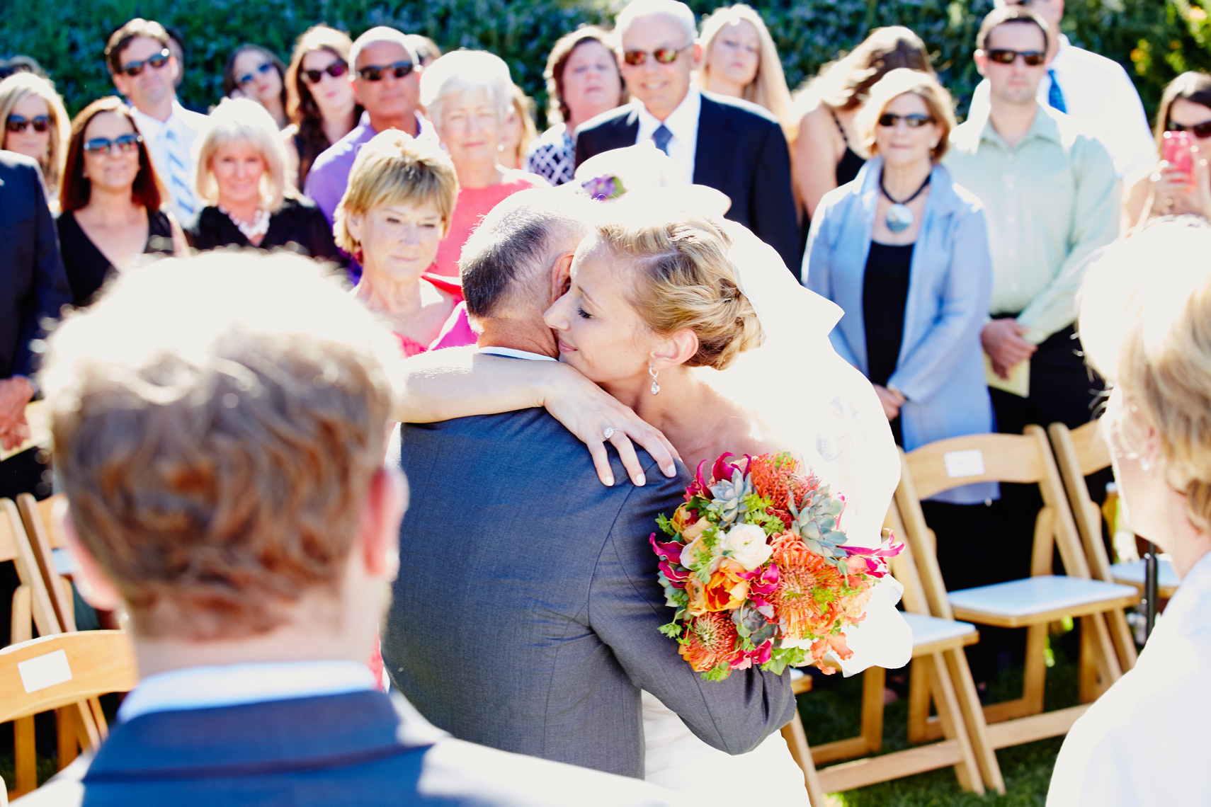 Father gives away bride before ceremony at private estate in Palo Alto, California.
