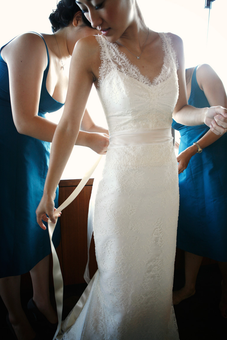 Bridesmaids assist Bride with wedding dress prior to wedding at a private estate in Napa valley, California