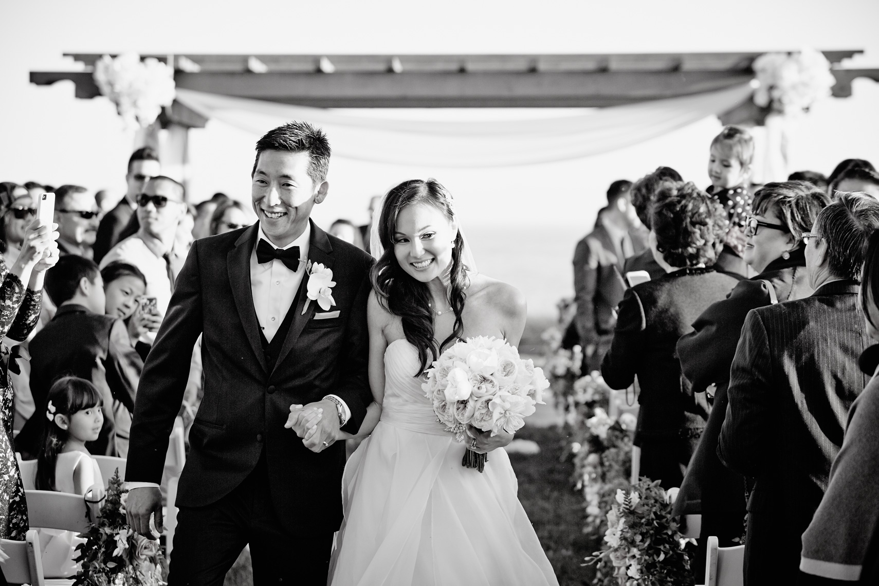 Bride and groom walk down the aisle after getting married at Terranea Resort in Rancho Palos Verdes, California.