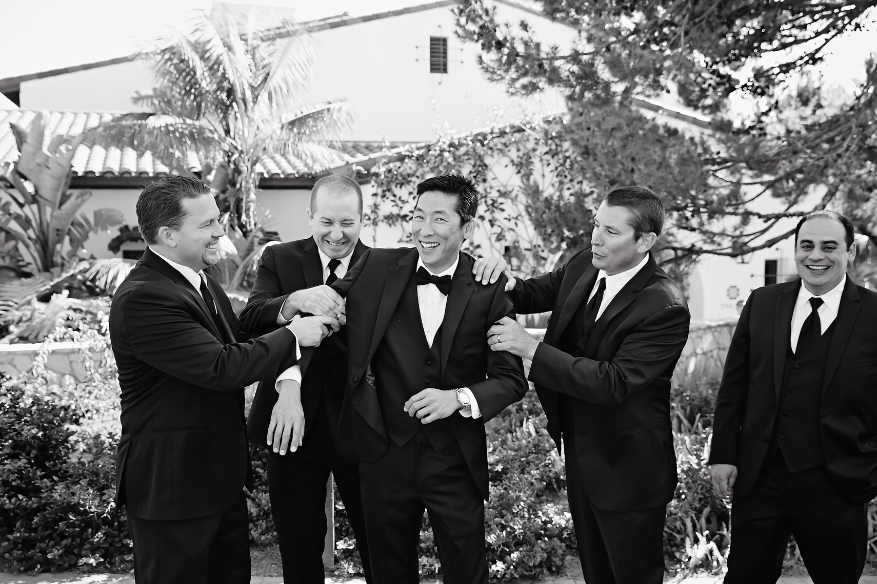 Groom and groomsmen have fun prior to wedding ceremony at Terranea Resort in Rancho Palos Verdes