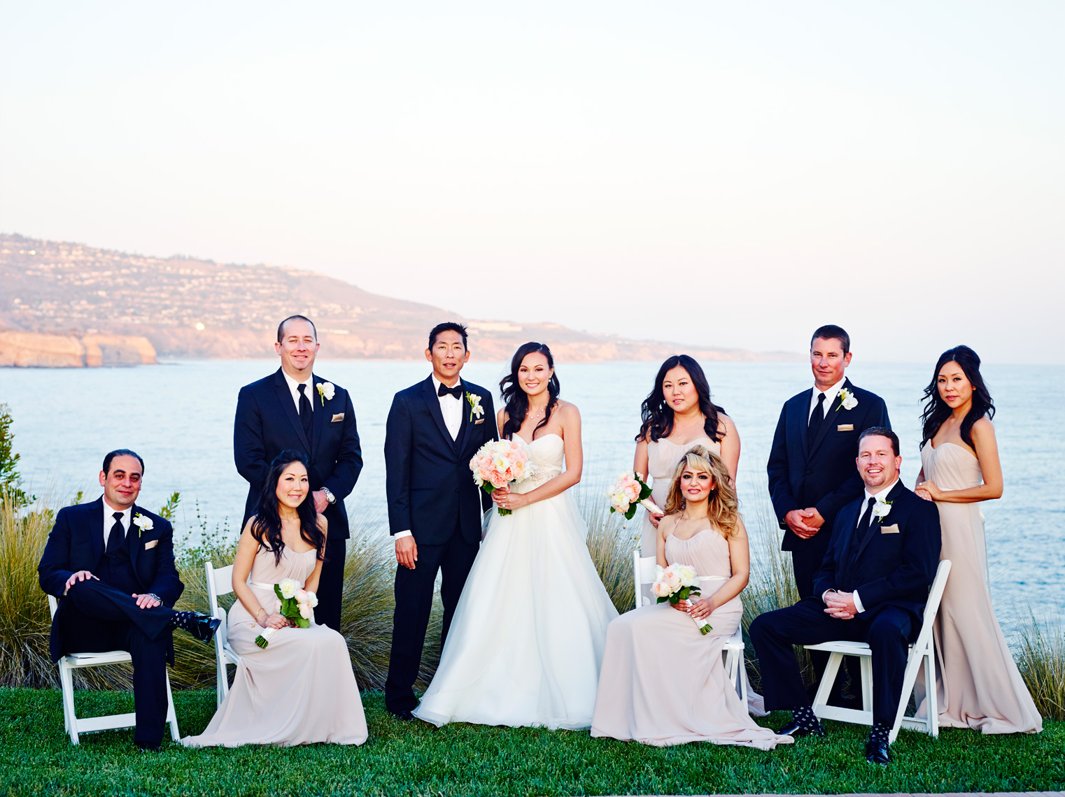 Bridal party poses for photographer at Terranea Resort in Rancho Palos Verdes, California