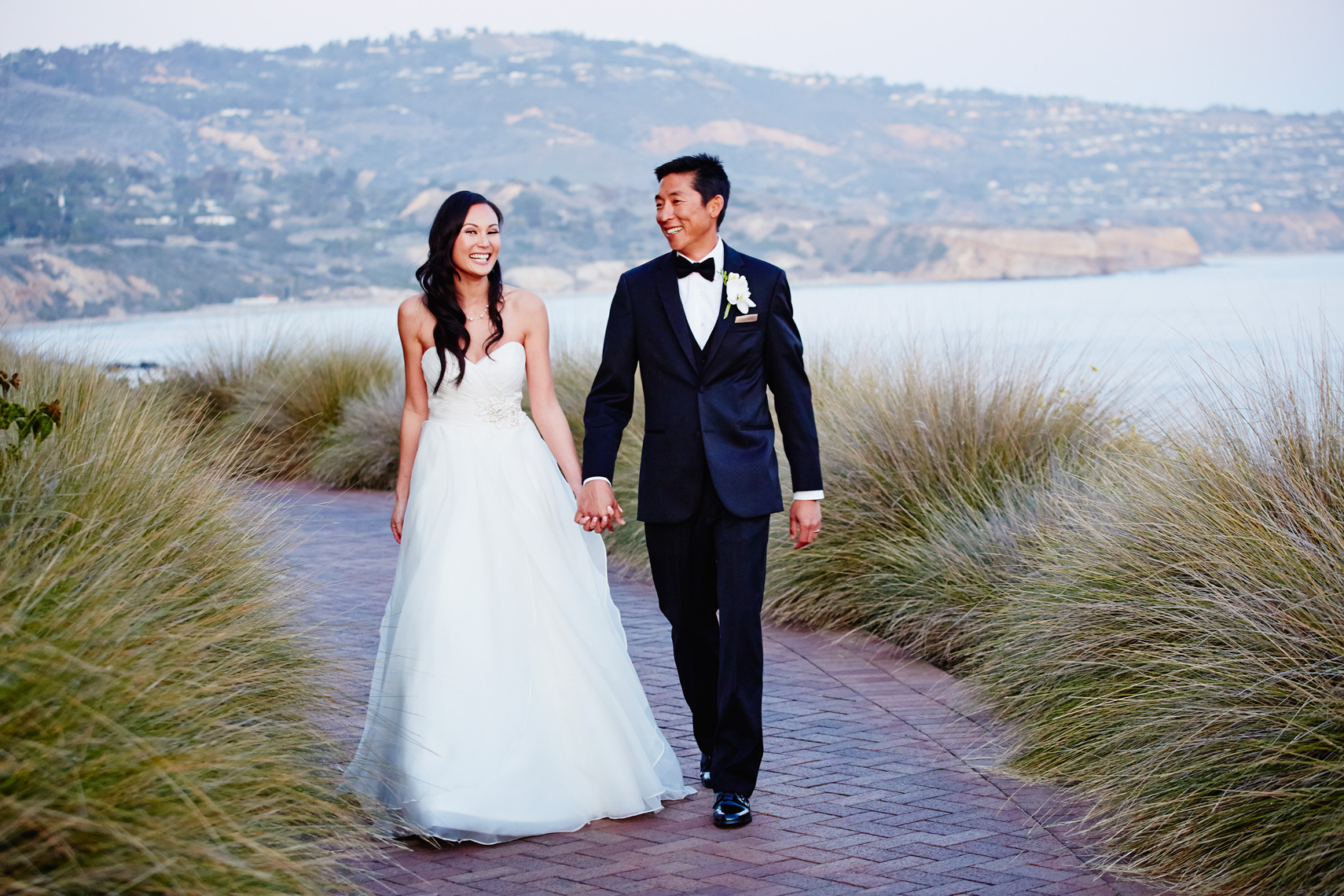 Bride and groom walk together after wedding ceremony at Terranea Resort in Los Angeles, California.