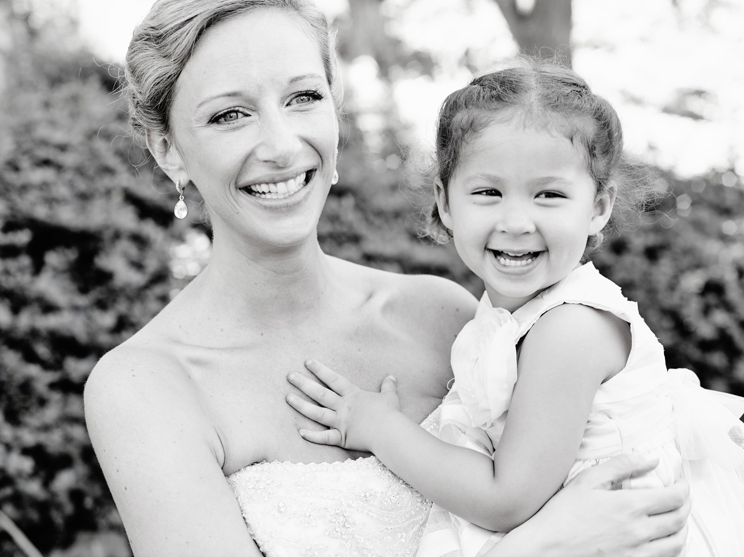 Bride with Flower girl after wedding ceremony at private residence in Palo Alto, California