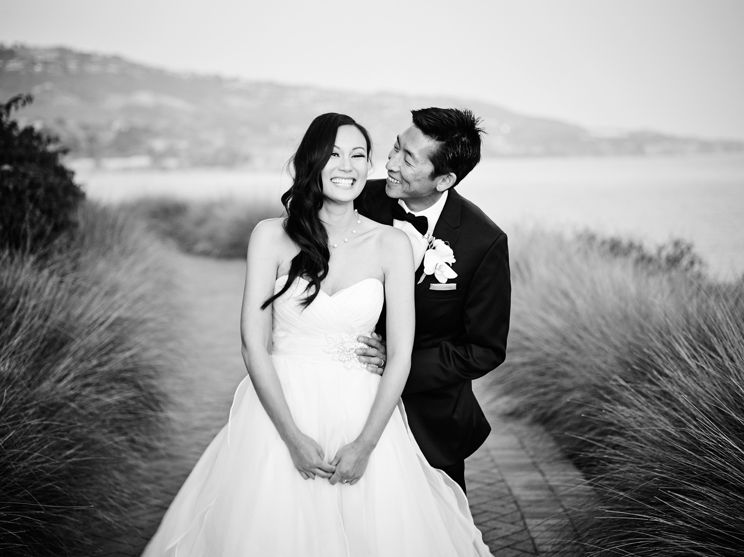 Bride and groom laugh together after wedding ceremony at Terranea Resort in Los Angeles, California.