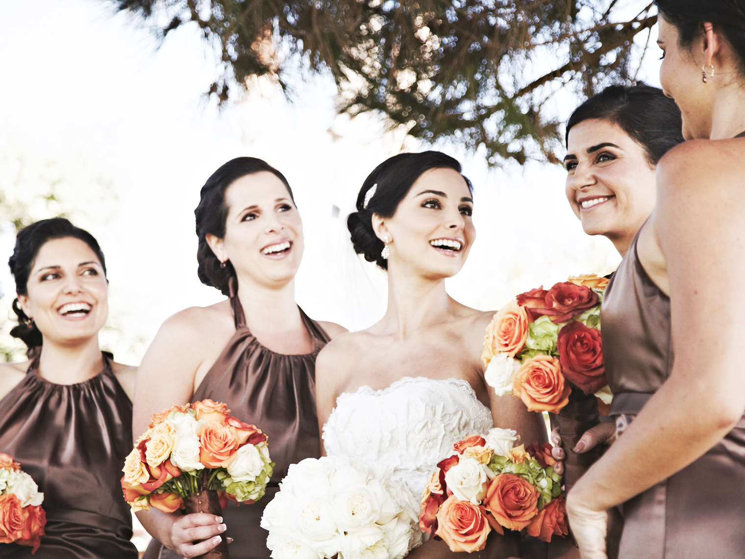 Brides with bridesmaids at Montage Resort Laguna Beach, California
