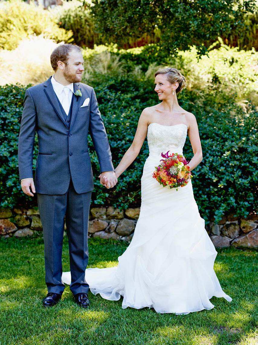 Bride and Groom look at each other after ceremony at private residence in Palo Alto, California