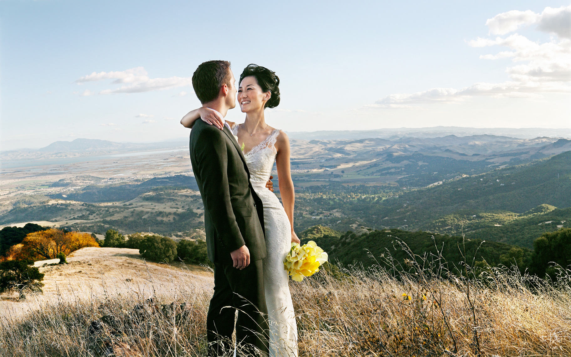 Bride and Groom Portrait over Napa Valley, California. Destination Wedding location.