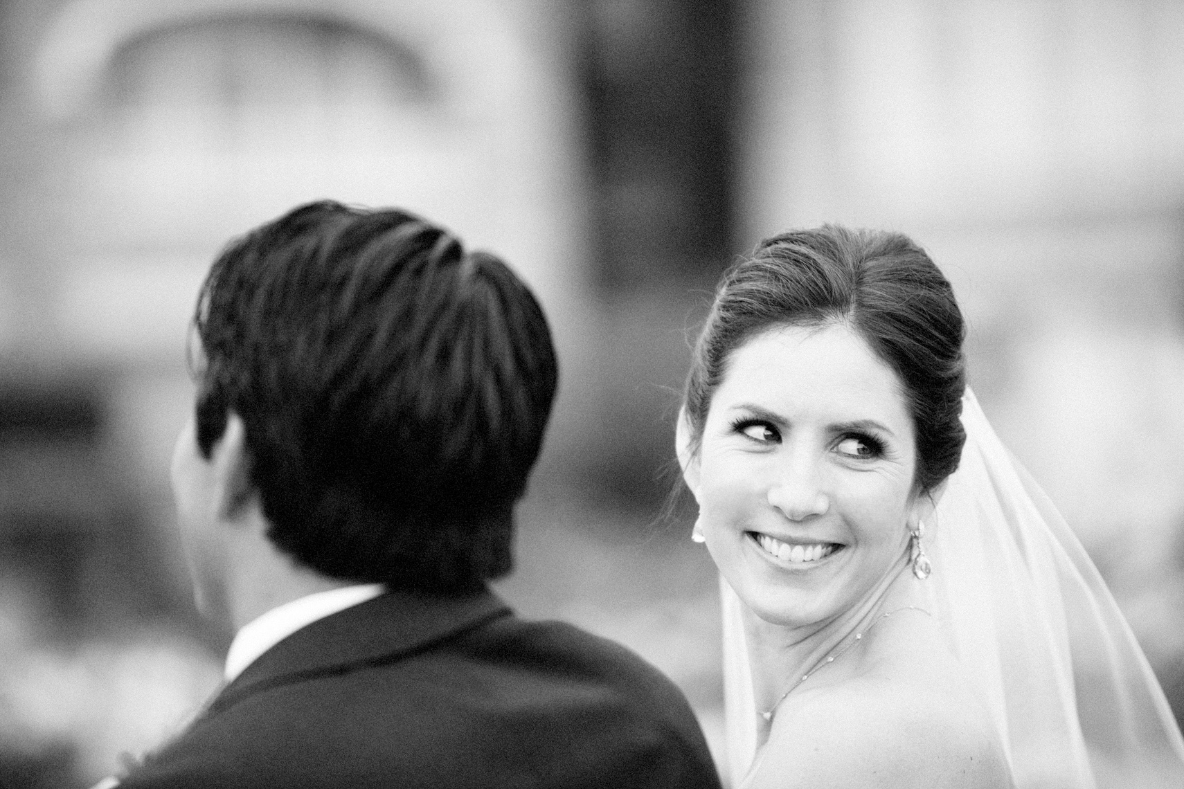 Bride smiles  during wedding ceremony on the Pacific Lawn at Montage Resort, Laguna Beach.