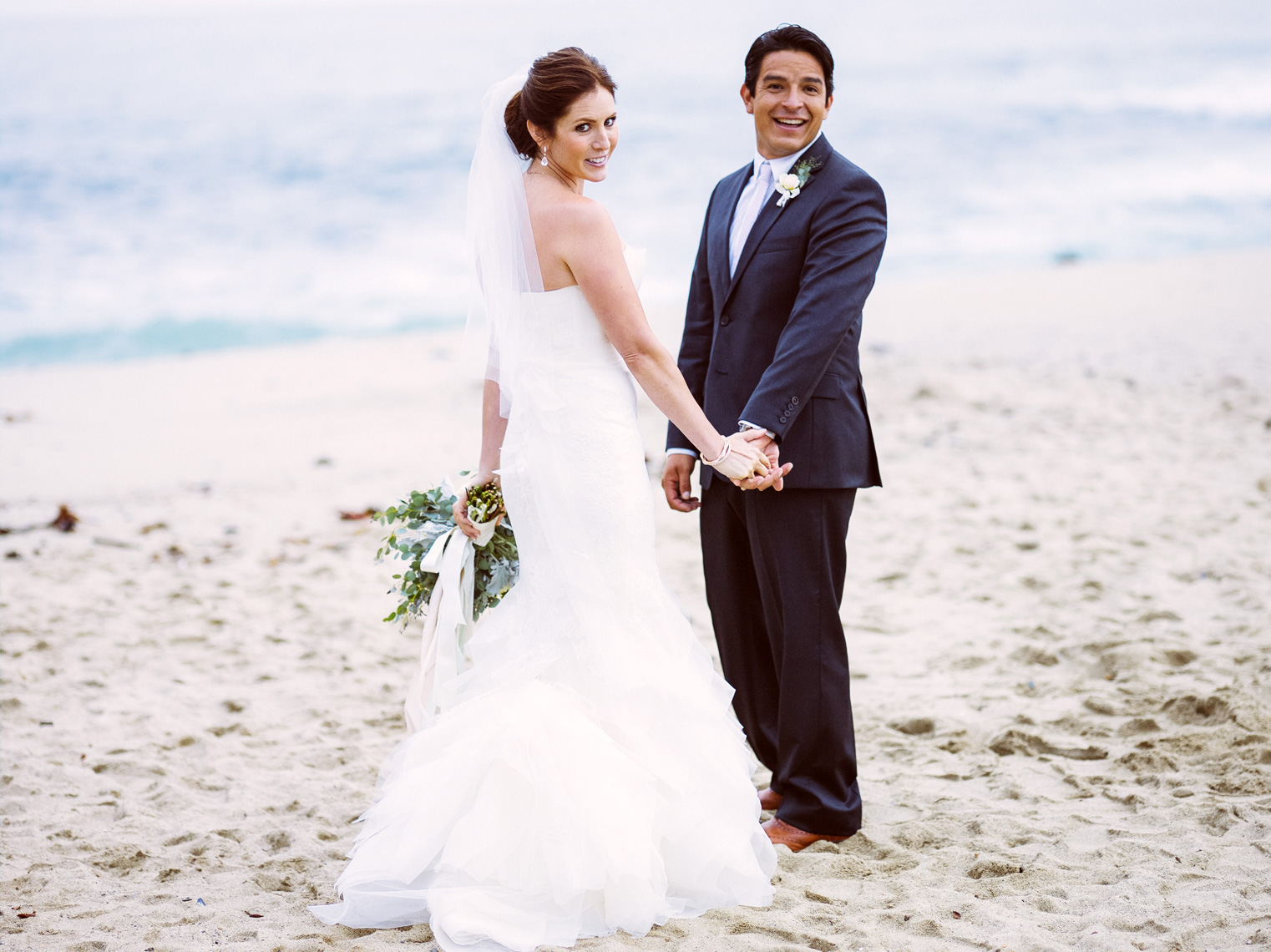 Bride and Groom smile after ceremony at Montage Laguna Beach, CA.