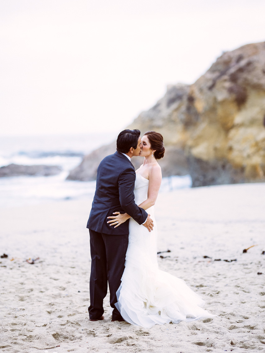 Bride and Groom kiss after ceremony at Montage Resort, Laguna Beach.