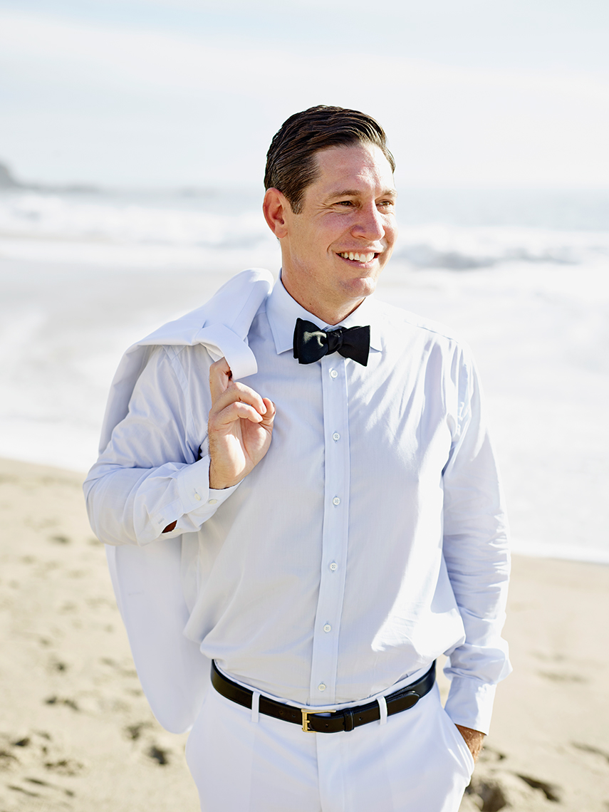 Groom poses at wedding in Laguna Beach, CA